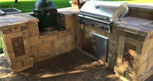 Grill and Big Green Egg in this Custom Belgard Outdoor Kitchen - Des Moines - Ce...